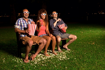 three friends in exterior cinema Stock Photo - 14996131