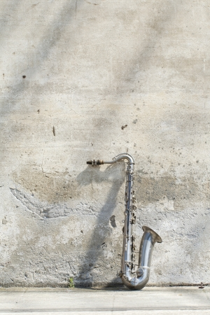 sax: sax leaning against the wall