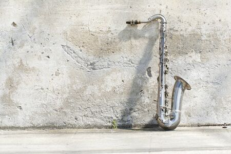 sax leaning against the wall