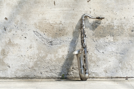 sax leaning against the wall photo
