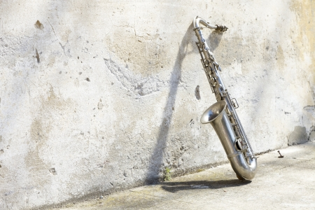 saxophone: sax leaning against the wall