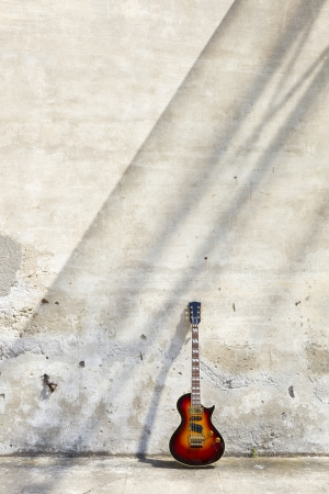 blues music: guitar leaning against the wall Stock Photo