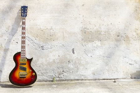 musical instruments: guitar leaning against the wall Stock Photo