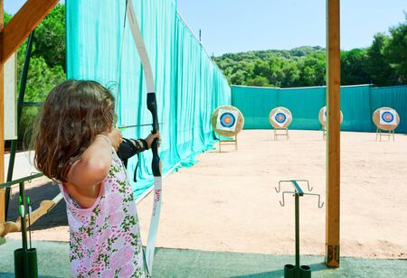 concentration camp: young girl makes archery