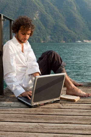 man writing on the laptop Stock Photo - 18788916