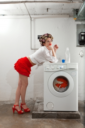 young woman in laundry, she waits photo