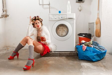 lavage: young woman in laundry, she drink Stock Photo