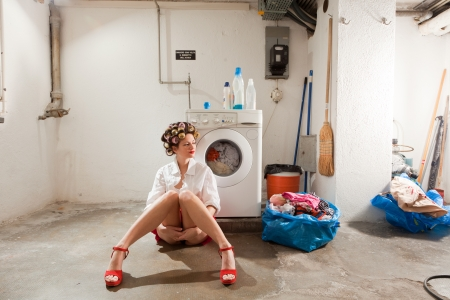 launderette: young woman in laundry, she waits