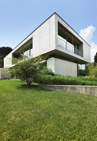 blue facades sky: Modern house in exterior, beauty garden