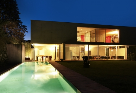 outdoor lighting: beauty house in the night with pool