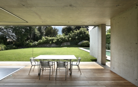 Veranda of a modern house with a beauty pool photo