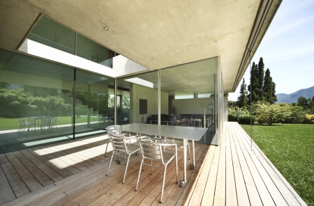 teck: table and chairs on the veranda  modern house