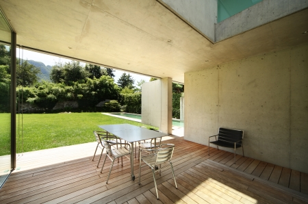 table and chairs on the veranda. modern house photo