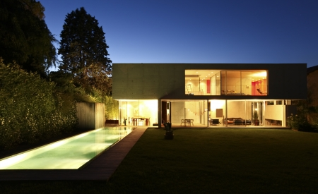 blue facades sky: beauty house in the night with pool
