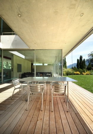 teck: table and chairs on the veranda. modern house Stock Photo