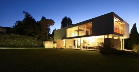 outside outdoor outdoors exterior: modern house, exterior at the night Stock Photo
