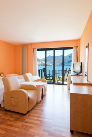 hotel room with exceptional views of the lake and mountains Stock Photo - 22549276