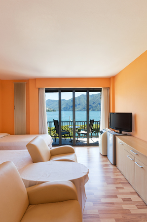 hotel room with exceptional views of the lake and mountains Stock Photo - 22549281