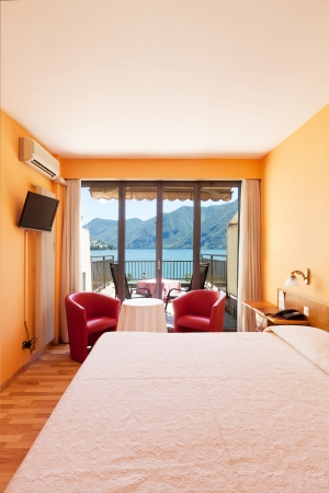 hotel room with exceptional views of the lake and mountains Stock Photo - 22541644