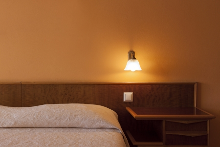bedside: particular to bedroom with light on, romantic atmosphere