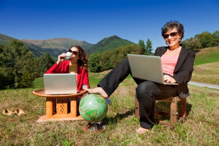 Businesswoman with computer in the park photo