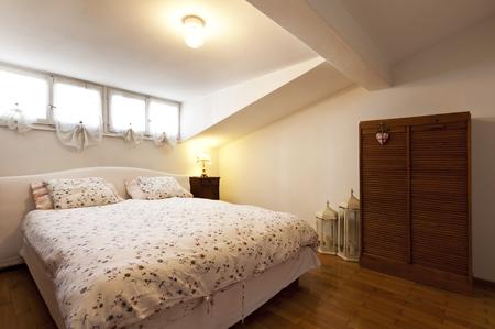 interior apartment, small loft furnished, bedroom Stock Photo - 23448733