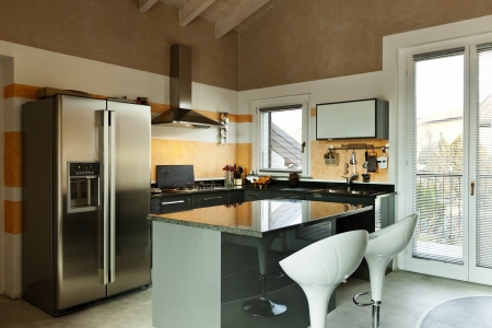 interior, new loft furnished, kitchen island with two stools  photo