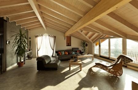 roof beam: interior new loft, ethnic furniture, living room  Stock Photo