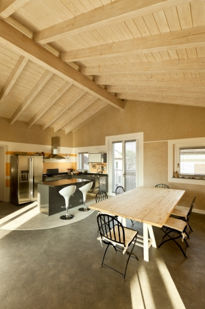 wood ceiling: interior, new loft furnished, view of dining table and kitchen