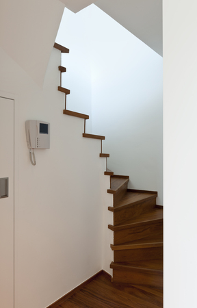 interphone: Modern apartment,entrance and wooden staircase