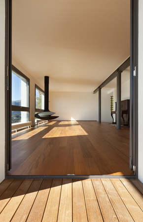 Modern apartment, entrance from the balcony, overlooking the living room photo