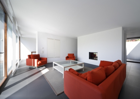 large living room with white walls and red couch Stock Photo - 23570607