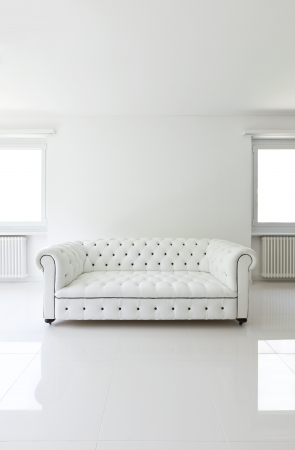 perspective: interior, leather sofa  in white room Stock Photo