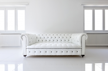 the white wall: interior, leather sofa  in white room Stock Photo