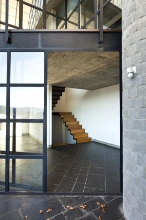 foyer: interior modern villa, balcony , wooden staircase