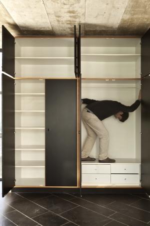 walk in closet: room with wardrobe, man inside