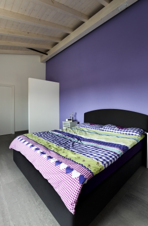 Interior design: purple modern Bedroom Stock Photo - 24188171