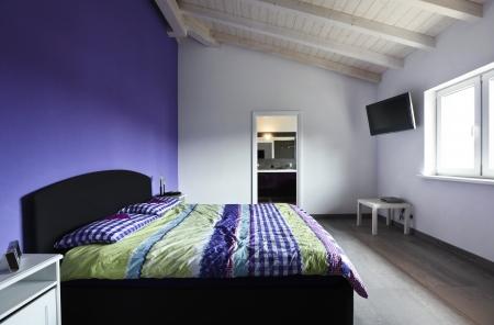 bedside: Interior design: purple modern Bedroom Stock Photo