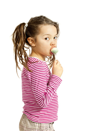 suck: Close-up of adorable little girl with a lollipop, isolated on white background