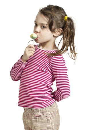 licking in isolated: Close-up of adorable little girl with a lollipop, isolated on white background