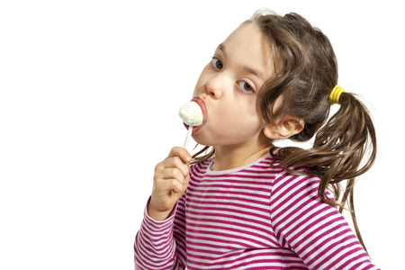 suck: portrait of little girl with a lollipop, isolated on white background