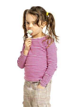 suck: Close-up of little girl with a lollipop, isolated on white background