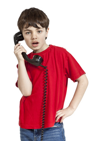 portrait of little boy on the phone, isolated on white background Stock Photo