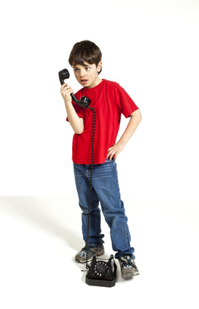 retro phone: portrait of little boy on the phone Stock Photo