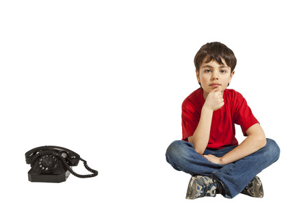 little boy expecting a phone call  photo