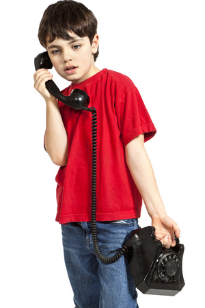 portrait of little boy on the phone, isolated on white background photo