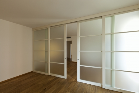 glass doors: interior empty house with wooden floor Stock Photo