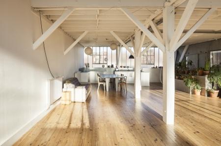 wide room of loft, beams and wooden floor  photo