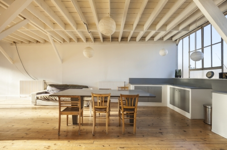 nice weather: wide room of loft, beams and wooden floor  Stock Photo