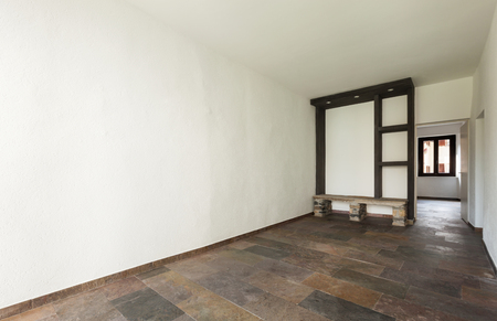 nterior old house, empty room with stone floor photo
